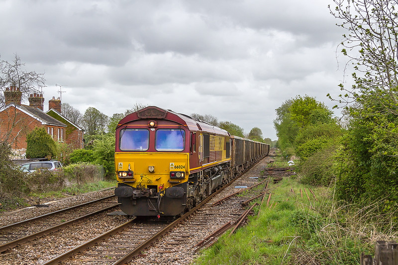 5th May 2015:  Passing the remnants of a Refuge Loop at Dean is 66024 working 7V16 from Fareham to Merehead,  Sun had become very scarce !