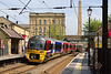 15th May 2015:  333004 is pictured leaving Saltaire with 2S37 the 14.04 from Skipton to Bradford Forster Square