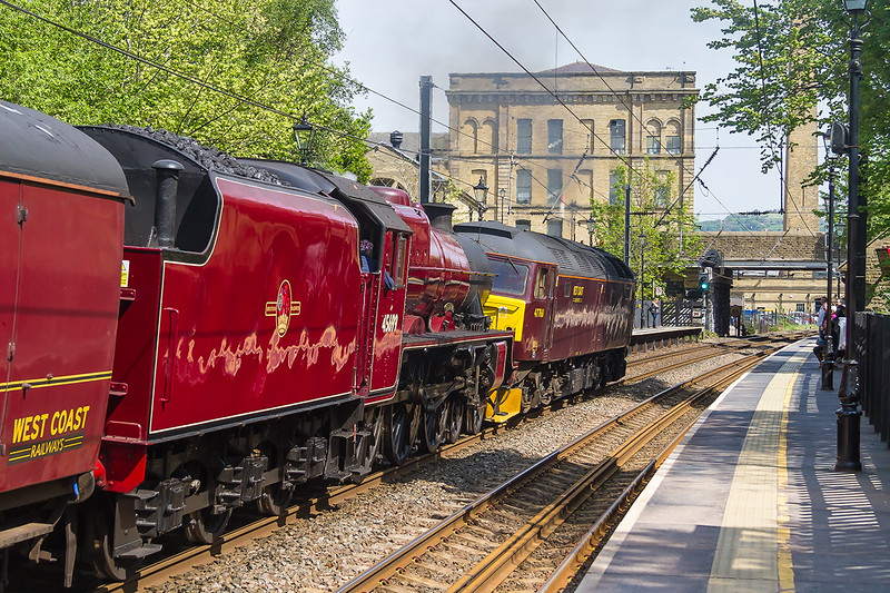 15th May 2015: A family visit to te Salts Mill Museum in Saltaire (in the back ground) allowed me a 20 minute visit to the station.  I had no idea that this was due but it certainly made my day.    47760 brings 45699 'Galatea' through Saltaire working 5Z73 from Carnforth to York Holgate Sidings.