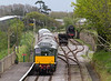 8th  May 2015:  The 34028 Edystone dumped in the sidong D5195 potters through Herston Halt during the Swanagew Railway Deisel Gala