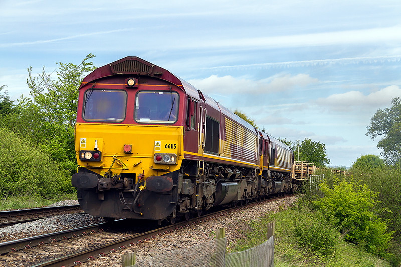 4th May 2015:  The morning Departmental from Westbury to Eastleigh 6O41 is in the hands of 66115.  Climbing through Dilton Marsh with 66024 DIT is Hauling Long Welded Rails,  Auto Ballasters and a single empty  sleeper carrier