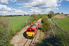 30th Apr 2015:  Now that the line had cleared 59201 was free to take the route to Merehead. At Wanstrow 7V07 is the returning empties from Chichester