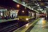 13th Nov 2015:  Unexpected and as far as I can see not listed on RTT 66070 trundles very slowly through Westbury's Platform 2 with the old RMC hoppers.  1/125 @ f4  iso 6400.    I now understand the train is going to Hither Green from Whatley Quary