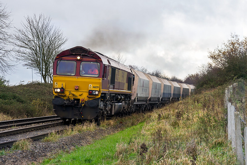 27th Nov 2015:  66129 heading 6M20 from Whhatley te St Pancras Churchyard Sidings on the Westbury New Line AKA Cut Off, Avoider.  Taken from the Oldfield Park foot crossing