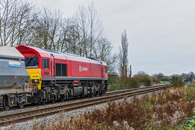 24th Nov 2015:  59206 has just passed the Lafarge Cement Works at Heywood Toad as it  hauls 6L21 the 13.30 Whatley to Dagenham Dock A R C stone