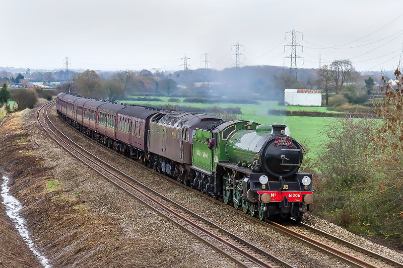 26th Nov 2015:  A serious problem (dragging brakes) with a coach in the middle of the rake resulted in a 114 minute late departure from Reading for the Cathedrals Express from Victoria to Minehead.  Powered by LNER B1 61306 'Mayflower' the train is captured from Pot Lane as it slows for the water stop in Frome..  47746 is tucked inside.