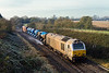 23rd Nov 2015:   With frost still covering the brambles the Didcot to Didcot RHTT 3J43 in the hands of 67014 & 67022 is spraying well as it passes through Broughton Gifford on the Bradford Junction to Thingley line