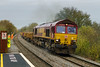 17th Nov 2015:  With 20 loaded JNAs and a rake of Sleepe Fflats in tow  66164 was working very hard on the climb through Dilton Marsh with 6O41 from Westbury to Eastleigh