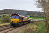 12th Nov 2015:  Nearing Glasses Crossing at Bathampton is 66039 working 6W05.  Earlier in the day DB stickeedr number 39 had worked Light Engine from  Margam to Westbury.  Having collected the refilled side tippers they are being worked back to Margam