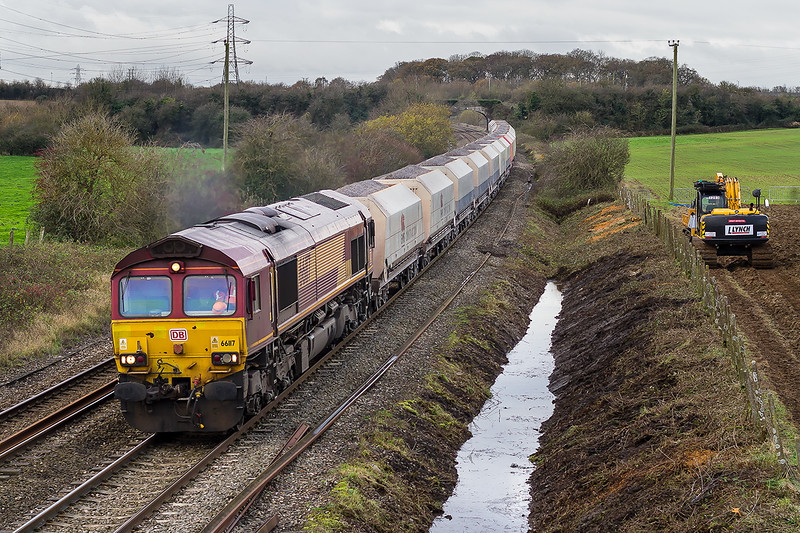 25th  Nov 2015: 66117 at Pot Lane in Berkley with 6A26 from Whatley to Hayes & Harlington.  Ditch clearing  had not started today because Gypsies had overnight broken into the dumper (beyond the digger) and smashed the control gear.
