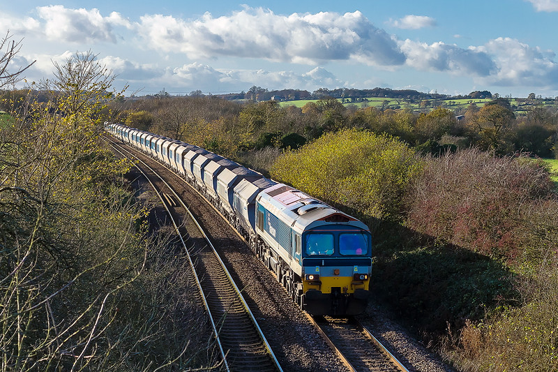 20th Nov 2015:  Taking the station line from Fairwood Junction is 59102 on the point of 6L21 from Whatley Quarry to Dagenham Dock