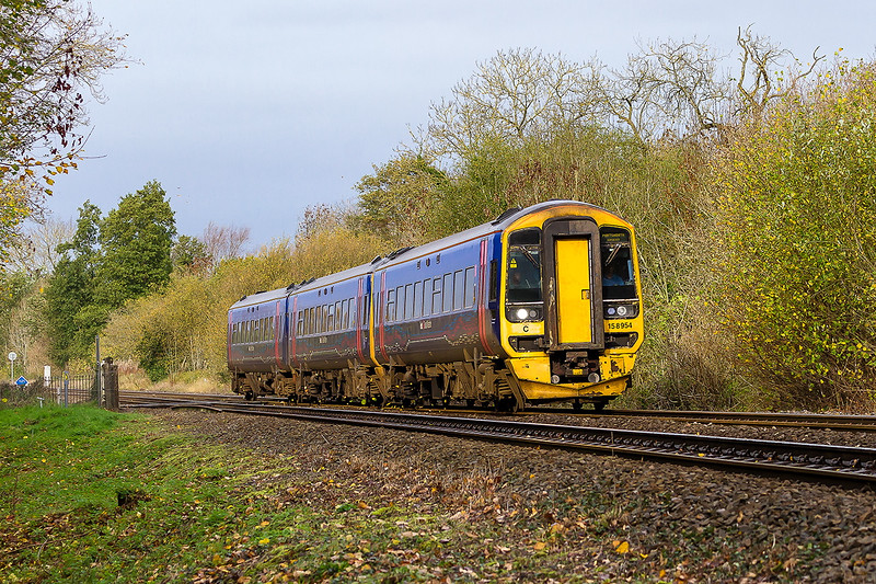 9th Nov 2015:  Catching a rare patch of November sunshine  is 158954.  1F07 the 08.30 from Cardiff to Portsmouth harbour has just crossed the foot crossing at Sherrington Lane in the Wylye Valley