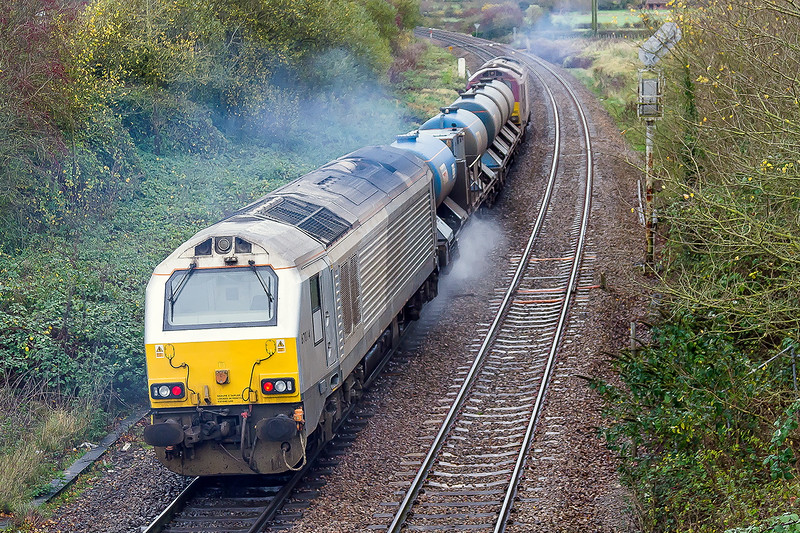 16th Nov 2015:  Starting to spray as they get away from Hawkeridge Junction are 67022 TnT 67014 on 3J43 the Didcot based RHTT on the last leg of this turn back to Didcot via the line through Melksham.  The smoke and spray combining to make a rather ill defined shot.  At least the rain had stopped.