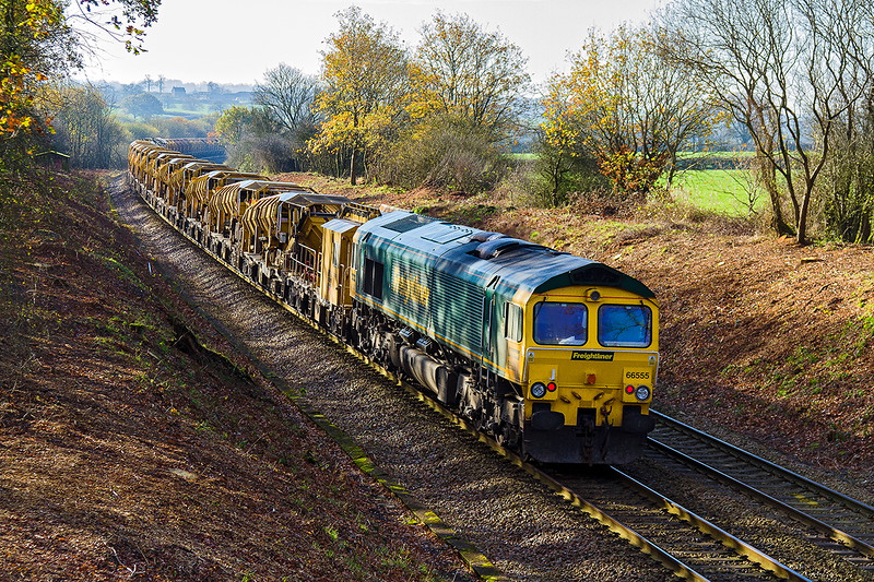 22nd Nov 2015:  With 66552 well out of sight 66555 brings up the rear of the full HOBC set.  6Y19 starting from Basingstoke and  heading for Fairwater Yard is running down Brewham Bank at Strap Lane in Upton Noble.  Recent tree clearance has opened up the shot in both direction.