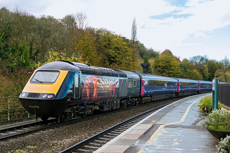 """7th Nov 2015:  Newly branded to honour the fallen in WW1 and in particular 'Harry Patch' 43172 on the rear of 1C12 the 11.27 from Paddington to Bristol Temple Meads leaves Bath Spa..    Unfortunately the train was running about 10 minutes late and at the very last minute the distant clouds cleared  allowing the extra light to reflect from the side  so blocking out the wording.  <br /> <br /> """"They shall grow not old, as we that are left grow old:  <br /> Age shall not weary them, nor the years condemn: <br /> At the going down of the sun and in the morning: <br />  We will remember them""""."""