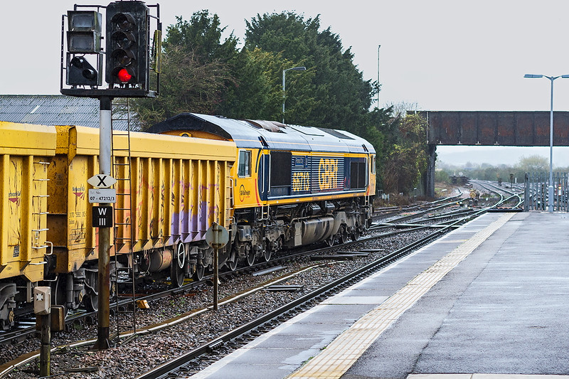 19th Nov 2015:  Having had a wash since my last shot of her 66713 'Forest City' starts away from Westbury on a cold and wet morning.  6M40 is taking the WIAs back to Stud Farm in Leicestershire for a ballast refill