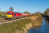 21st Nov 2015:  Climbing away from Bedwyn beside the Kennet and Avon Canal is 60054 with the diverted 6B33 empty Murco tanks from Theale to Robeston