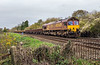 9th Nov 2015:  66083 clatters pasr the crossing at Sherrington Lame with 3O41 from Westbury to Eastleigh