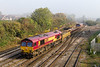 4th Oct 2015:  As the mist starts to clear 66090 bring s a very short 6W01 from Ebbw Junction basck to Westbury.66059 is at the rear