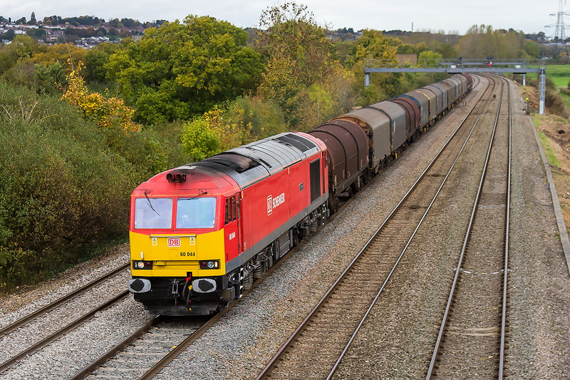23rd Oct 2015:  Now repainted into Schenker Red 60044 plods though Duffryn with 6H35 steel empties from Birdport (Uskmouth) to Margam
