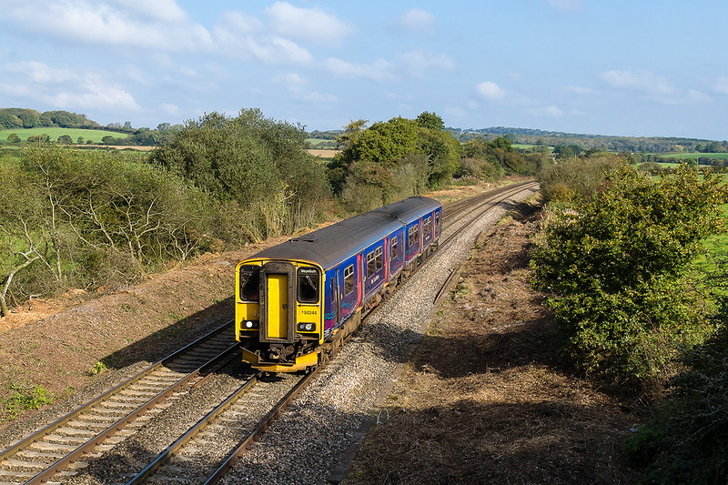 13th Oct 2015:  In beautiful Autumn light 150244 forming 2O86 the 08.42 from Gloucester to Weymouth is seen at Strap Lane near Upton Noble in Sowerset