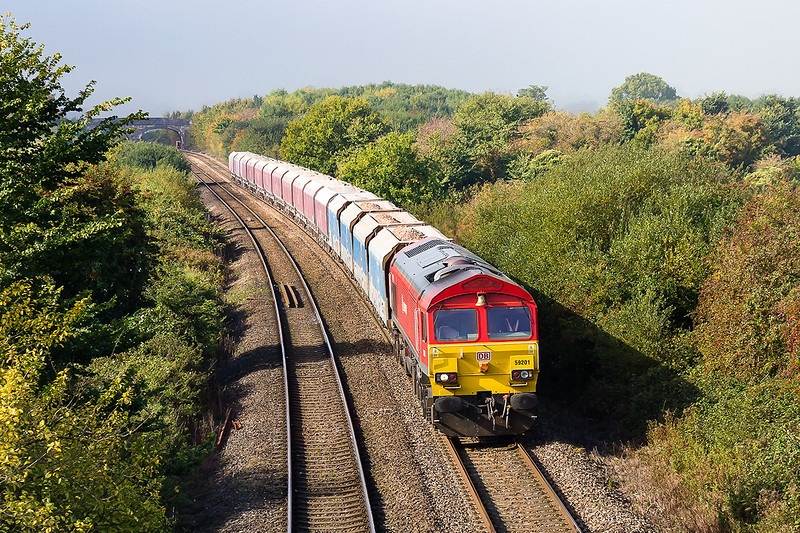 9th Oct 2015:   At Fairwood 59201 with the 'Bell' end leadig is pictured  with a mixture of Yeoman Hoppers and EWS ex coal HTAs forming 6B12 from Merehead to Wootton Bassett