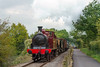 17th Oct 2015: The Avon Vally Railway  got all three London Transport liveried locos to gether for the Autmn Event.  Here the oldest, Metropolitan 0-4-4T No 1 of 1896, brings the demonstiontion freight train up the grade  fron Avon Riverside to Bitton.  Originally this Midland Railway line was double track and the disused track bed is now a very busy cycleway.