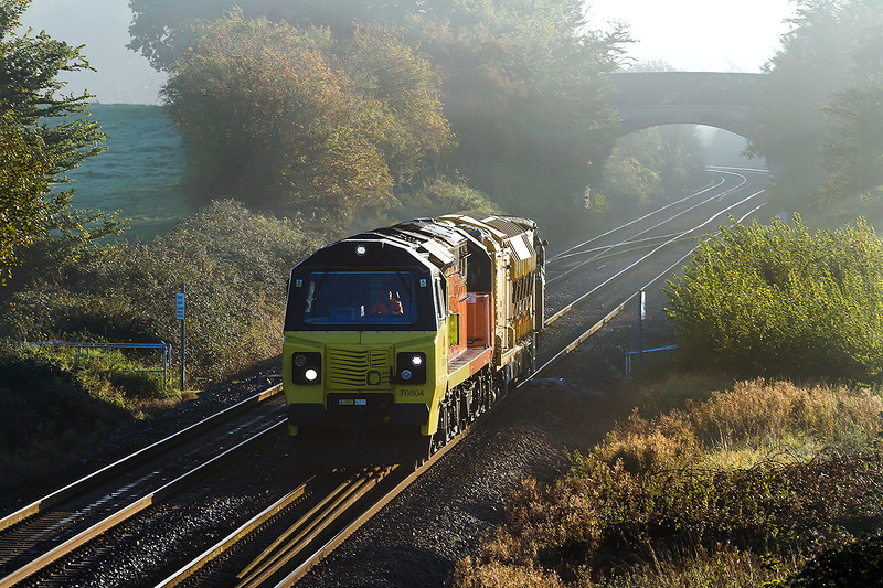 14th Oct  2015 6X54 is the code  for Colas 70804 to takie a Railvac from Westbury to Lostwithiel Clay Sidings.  The location is Fairwood. According to Network Rail the  visibility for persons using the crossing  to get from Right to Left is perfectly adequate. mm!
