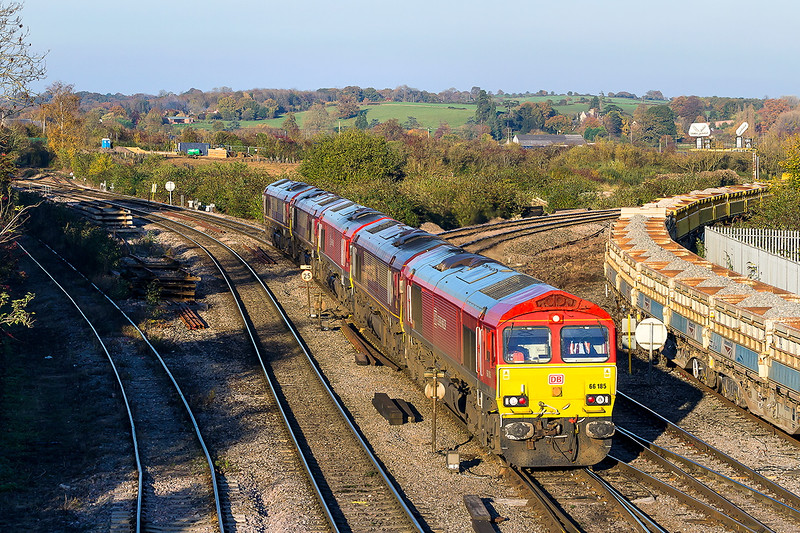 31st Oct 2015:  Despite what the weather forecast said the afternoon turned out to be beautiful.  Unfortunateley there was nothing of particular interest  scheduled to run.   5  locos on the Margam to Eastleigh convoy was the best that there was.  Here 66185/ 66172/ 66114/ 66039 & 66154 are pictured as they  get to Westbury.  The Berks & Hants line is seen curvring away to the right