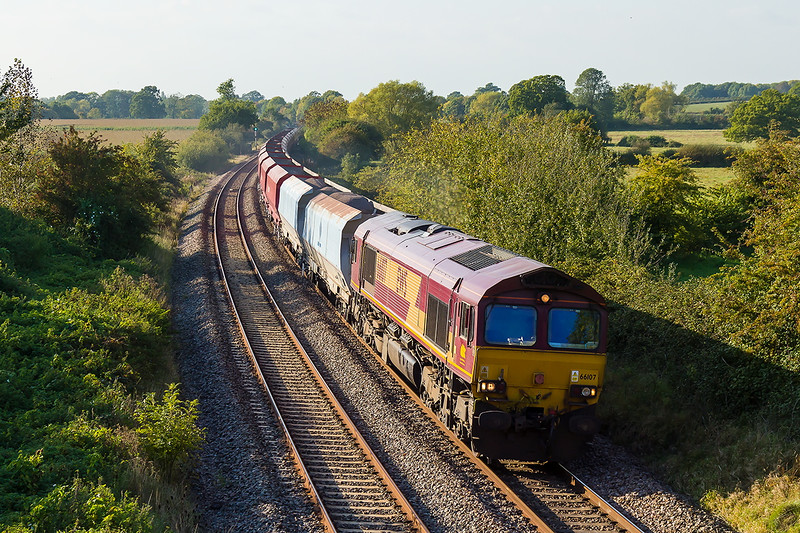 12th Oct 2015:  6A83 is the 13.28 from Avonmouth Bennets Siding to Theale.  With 66107 on the point it is pictured at Great Cheverell