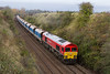 30th Oct 2015:  Working very hard with 20 loaded hoppers in tow is 59205 as it gruinds up the final 1/2 mile to the summit at Upton Scudamore  as it works fronm Westbury to  Eastleigh .