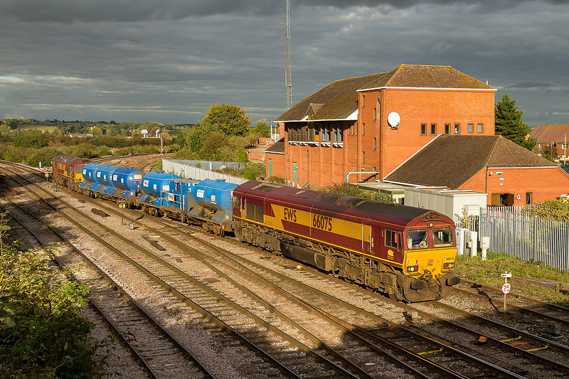 8th Oct 2015:  3J41 is the Didcot Refueling Point out and back  to Paddington and then Westbury via the Berks & Hants line.  In a fortunate patch of sun 66075 and 66206 are  captured as they  pass the  Westbury Power Signal Box