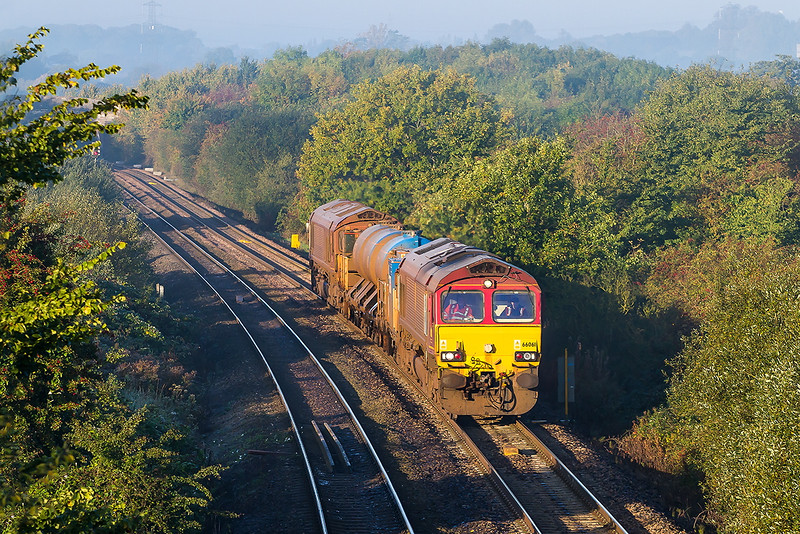 14th Oct 2015:  On a beautiful but with a touch of frost morning 66061 has stopped spraying as it runs on the station line at Fairwood.  3J12 RHTT is working from Par to Westbury