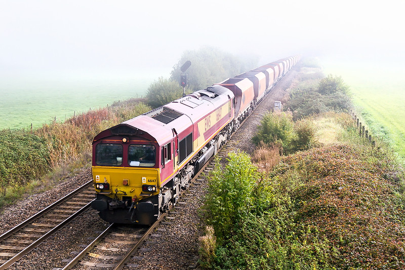 9th Oct 2015: The early morning mist still lingering masks 66147 as it accelerates away from Westbury with an early running 6V18 from Hither Green to Whatley Quarry