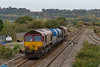 23rd Oct 2015:  3P50 the RHTT set  based on Barton Hill in Bristol has just passed through Pilning station and is starting the climb to Patchway. 66170 brings up the rear with 66119 on the front