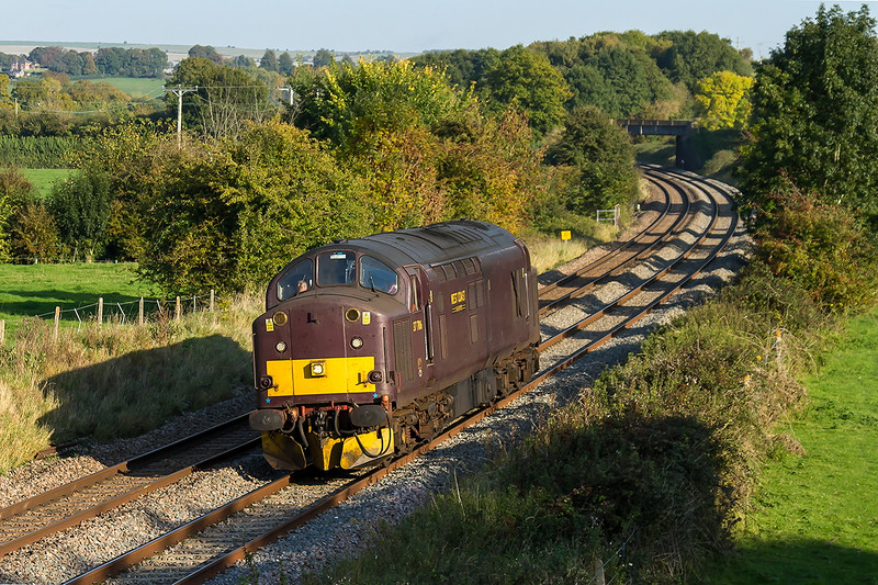 12th Oct 2015:  Not the usual scene on the Berks & Hants is a class 37.  At Great Cheverell  West Cpast Railways 37706 is heading for Westbury having started from the WCR Depot at Southall