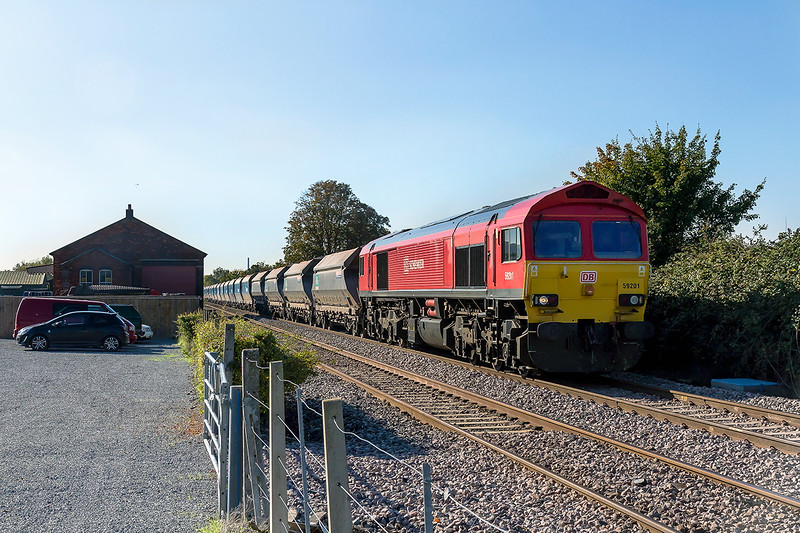 12th Oct 2015:  Pasing the site of Edington & Bratton goods yard is 59201 in charge of 6L21 from Whatley Quarry to Daggenham