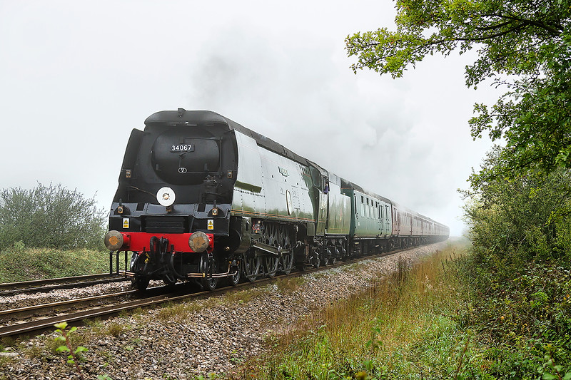 19th Sep 2015:  With the early morning mist just starting to lift 34067 'Tangmere is captured at Masters Crossing as it accelerates away from Fairwood Junction.  1Z70 is travelling from Paddington to Miehead.  At Williton it will be replaced by 6960 Raveningham Hall
