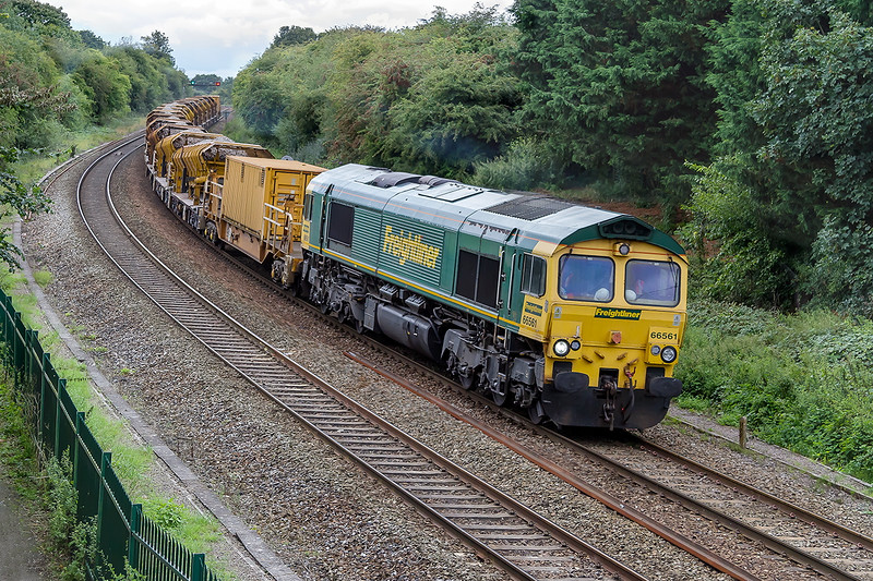 3rd Sep 2015:  The refilled HOBC returns to Fairwater Yard via Bristol behind 66561,  presumably to turn the set round.  The location is Ladydown in Trowbridge