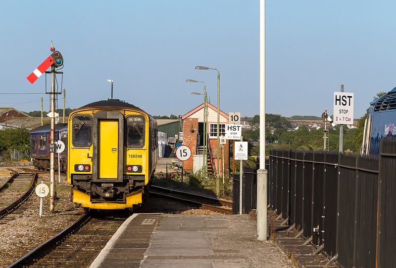 9th Sep 2015:  150120&150248 depart from St Erth with the 17.48 to St Ives  in platforn 2 43017 preapares to depart with the 17.49 departure to Paddington