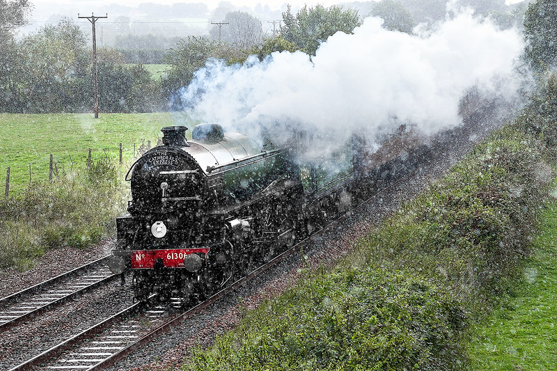 22nd Sep 2015:  The day's Cathedrals Express was from Horsham to Bristol Temple Meads and whlist the day did not look prommising seeing the B1 61301 would be worth the effort..  Although there were patches of sun about they passed bye and Great Cheverell attracted a  big blackie.with the sound of the train in the distance it started to rain and rapidly turned into a cloud burst.  Next time better luck perhaps!