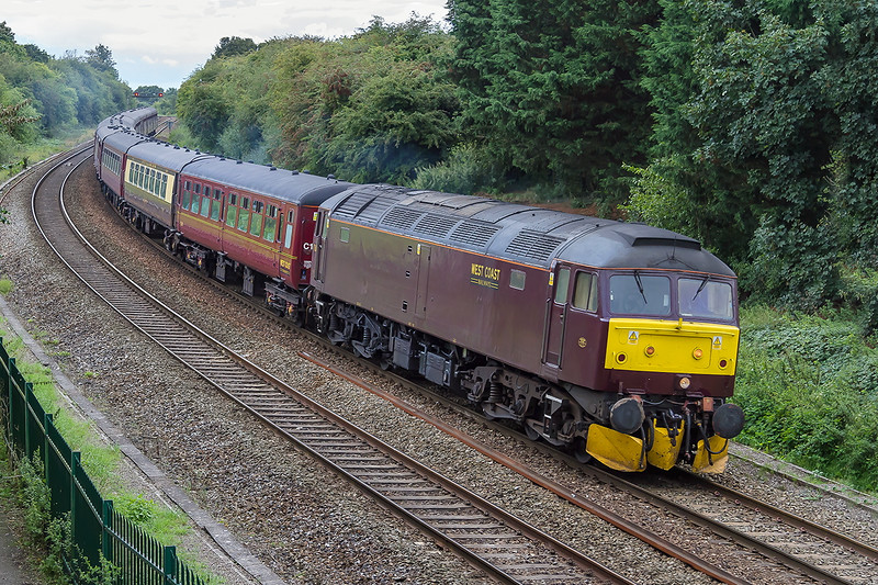 3rd Sep 2015:  Until the 1st September the all the passengers on this well loaded 'Cathedrals Express' from Rugby to Bristol Temple Meads expected to be hauled bty LMS 4-6-2 'Duchess of Sutherland' after all this is what they had paid for.  At this point the numpties at Network Rail decided that there wer 71 'issues' and '17 prohibits' between Hanwell and Bristol that the loco might hit something, so said that it could not be used for this section of the tour.  Presumably they have just realised that they have  installed the electrifiation masts too close to the tracks or in other words that have no idea what they are doing.  47760 at Ladydown in Trowbridge powered the train from and back to Southall.  What a shambles !!!