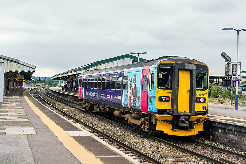 5th Sep 2015:  Now sporting the 'Visit South Devon by Train' livery 153333 arrives at estbury when working 2M58 the 14.36 from Swindon.  I thought that the line to Kingsbridge was closed !!!
