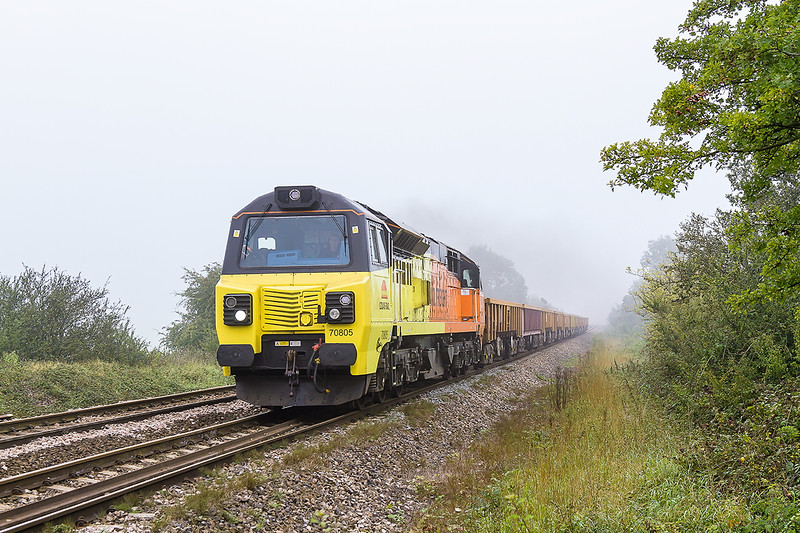 19th Sep 2015:  70805 and the second of the morning's departmentals, 6C24 to Par, at Masters Crossing near Fairwood.  The mist though thinner still masks the sun.