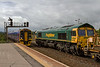 15th Sep 2015:  As it arrives at Westbury 158946 with 1F14 the 10.23 from Portsmouth to Cardiff  it passes 66560 waiting to return to Fairwater with the re-filled HOBC
