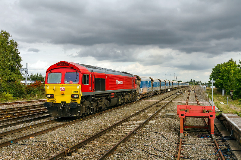 17th Sep 2015;  Having run round 59204  runs back on Swindon's 'Through Line' with 7B12 from Merhead to Wootton Bassett where the unloading sidings can only be accessed fron the Down Bath line.