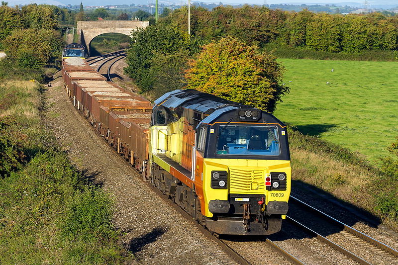 27th Sep 2015:  70809 on thw tail of 6C20 from Largin to Westbury at Berkley between Frome and Westbury