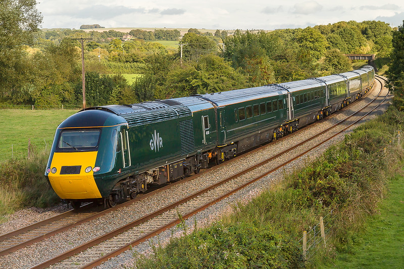 21st Sep 2015:  Having stood in full sun for 30 minutes a floater  spoiled the view at just the wrong moment.  43188 on the tail of 1J99 the 14.35 Exeter to Paddington at Great Cheverell.  This was the return working of the newlley rebranded Great Western Railway set used for the new Franchise launch earlier in the day.