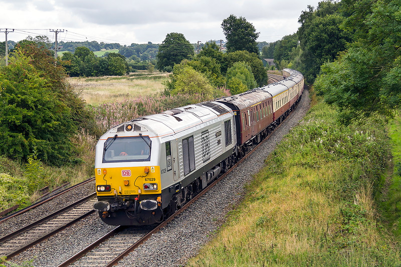 5th Sept  2015:  Just past thr site of Lavington Station 67029 'Royal Diamond' is captured racing down the grade with 1Z15 from Northampton to Paignton