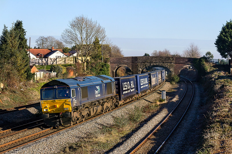 19th Jan 2016:  66426 working 4V38 the 'Tesco Express' from Daventry to Wentloog is making the best of the new veiw point from the replaced foot bridge at Magor